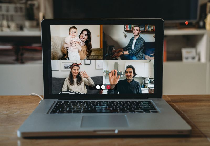 People working remotely on a video call, welcoming their new teammate.