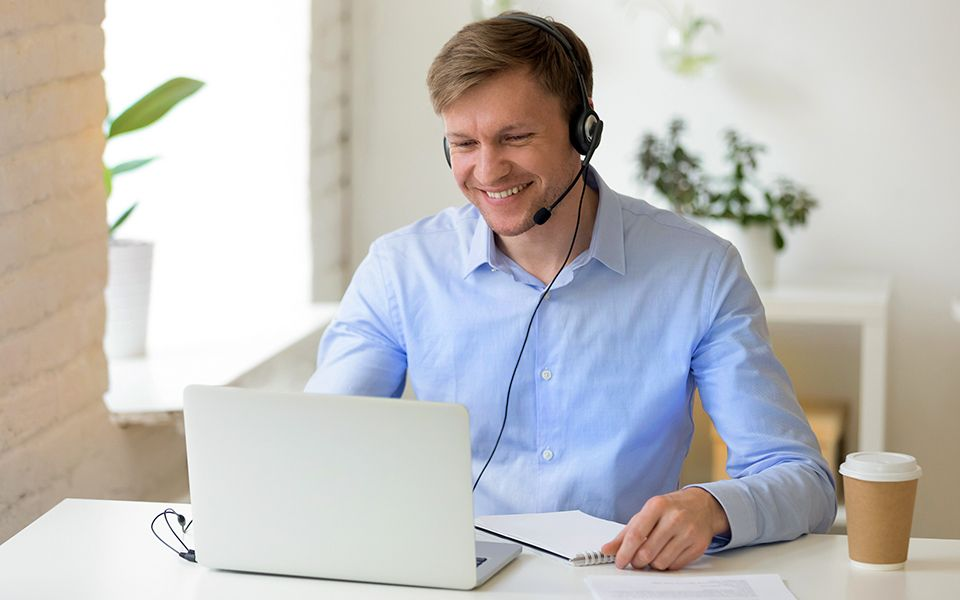 A man doing an online job interview