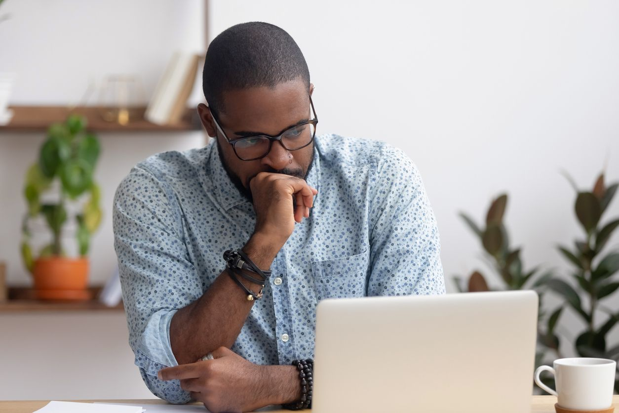 Man waiting for an email from a recruiter