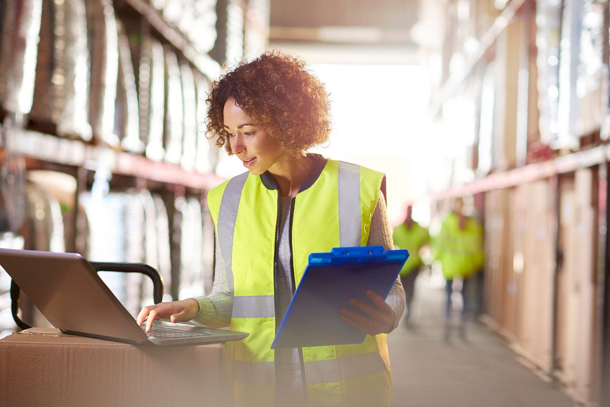 Woman working in distribution centre.
